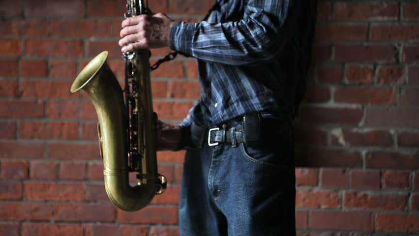 A man playing a saxophone | Shutterstock HD Video #2278514