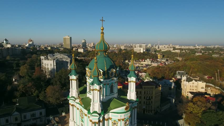 Descending aerial reveal of Saint Andrew's Church. A major Baroque church in Kiev, Ukraine. Constructed in 1747-1754, situated on steep Andriyivska Hill & overlooking Podil neighborhood. Oct 1, 2016. | Shutterstock HD Video #22788724