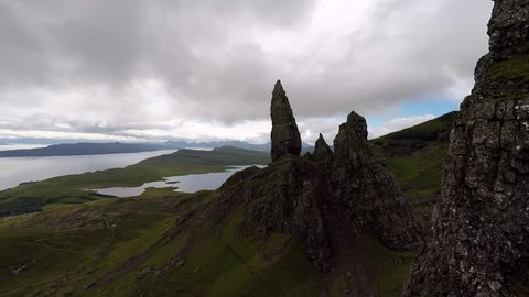 Rocky Cliff Aerial Footage of the Old Man of Storr rock formations on the Isle of Skye, Scotland. This location looks very alien and mythical and presents an amazing view of the surrounding areas.