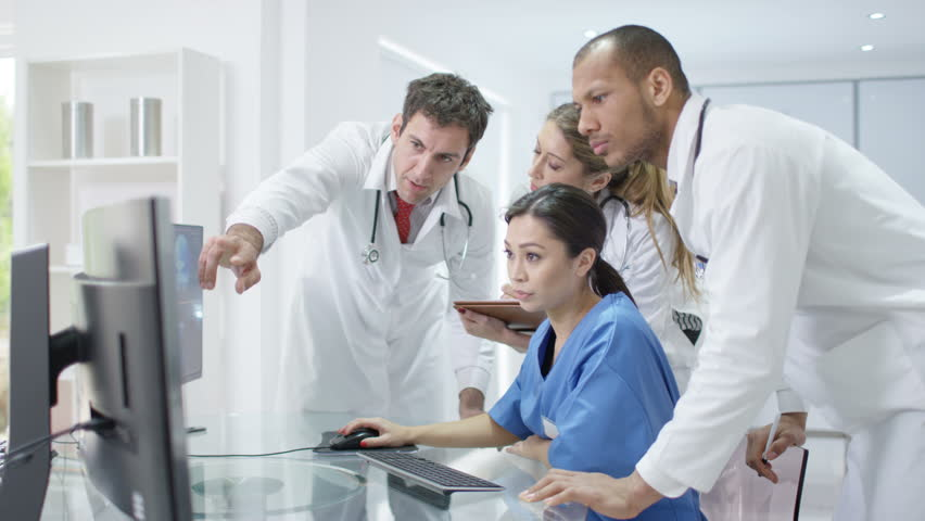 4K Medical team in modern hospital looking at computer & having a meeting Dec 2016-UK