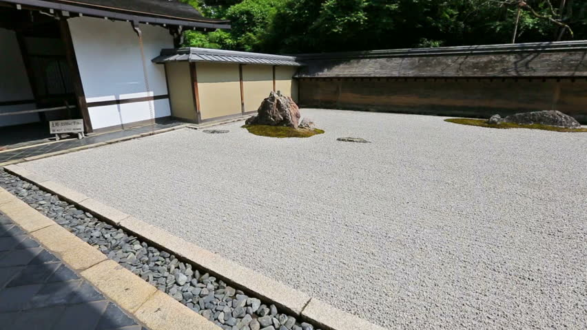 Zen Rock Garden in Ryoan-ji Temple, Kyoto, Japan. The stones are placed so that the entire composition cannot be seen at once from the veranda.