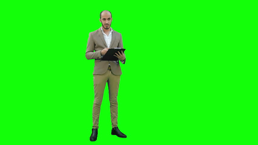 Manager holding clipboard and presenting business report on a Green Screen, Chroma Key.