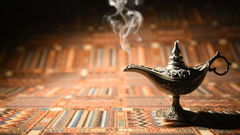 Aladdin oil lamp of oriental tales on traditional tablecloth.