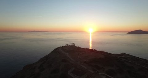 Aerial shot of the temple of Poseidon in Athens during sunset time