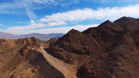 Eilat, Israel - Aerial footage over Solomon's mountains, revealing Eilat's skyline and the red sea