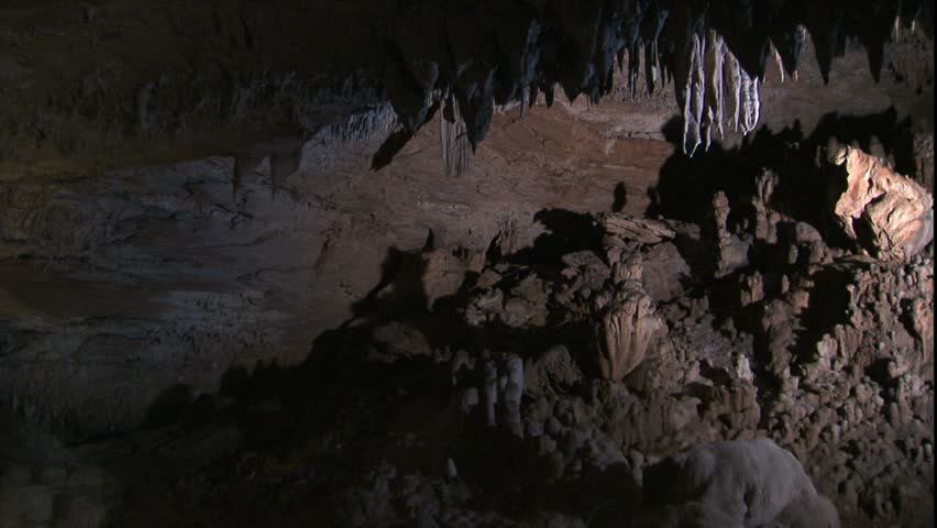 Pan from stalactites to cave room