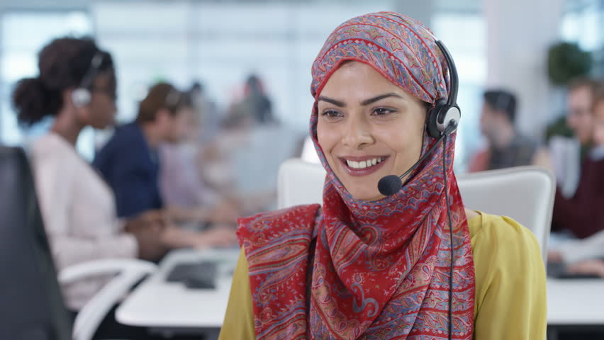 4K Friendly call center worker wearing hijab talking to a customer on the phone Dec 2016-UK   Shutterstock HD Video #22933174