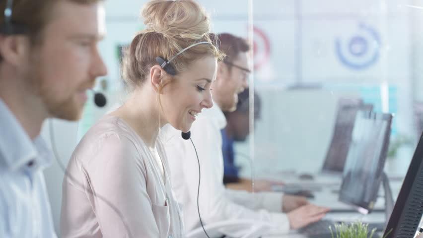 4K Friendly customer service operators taking calls in busy call center Dec 2016-UK | Shutterstock HD Video #22933774