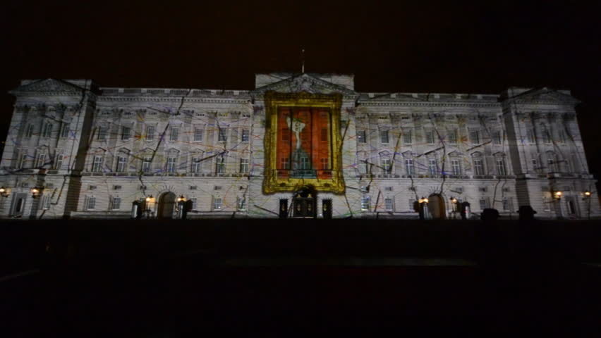 LONDON - APRIL 21: Buckingham Palace projection shows the portrait of Queen Elizabeth, self-portraits of young people and other images in the art project Face Britain on April 21, 2012 in London, UK.