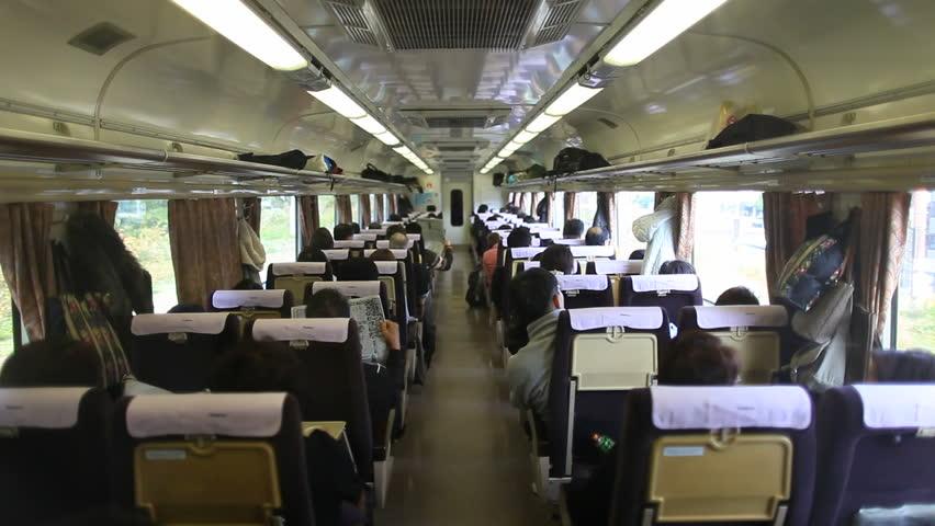 Tokyo, JAPAN - CIRCA NOVEMBER 2013- Shot of Japanese wagon traveling in train   Shutterstock HD Video #23011048