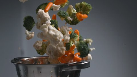 Vegetables flying out of colander in super slow motion, shot on Phantom Flex 4K