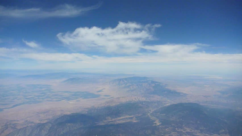 Flying in airplane over California.