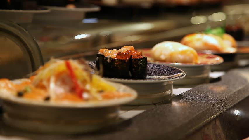 Conveyor belt sushi or rotating sushi in a Japanese restaurant inside a food court restaurant in Tokyo, Japan