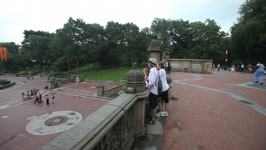 New York - Circa 2009: Central Park in 2009. Pan from right to left of pedestrian bridge to Bethesda Fountain below in New York CIty, New York.