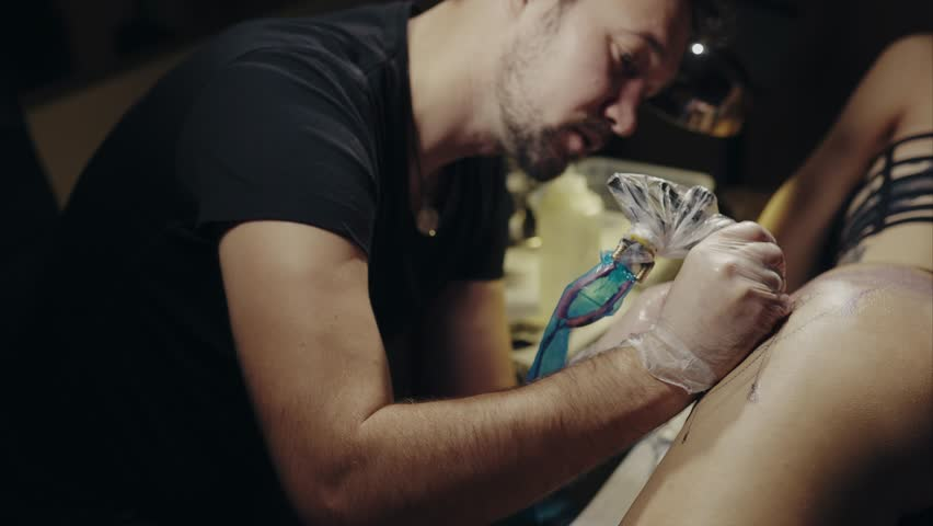Tattoo artist make tattoo at the studio 4K | Shutterstock HD Video #23079556