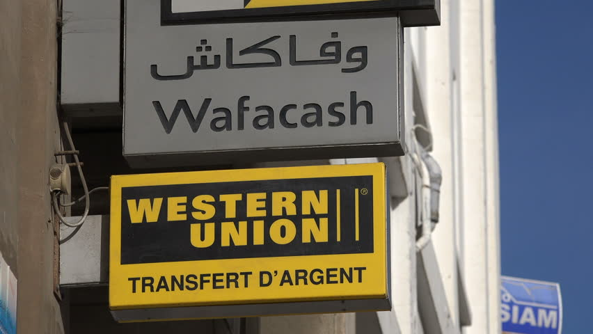 RABAT, MOROCCO - DECEMBER 2016: Western Union and bank office in French, English, and Arabic on the streets of Rabat in Morocco | Shutterstock HD Video #23091544