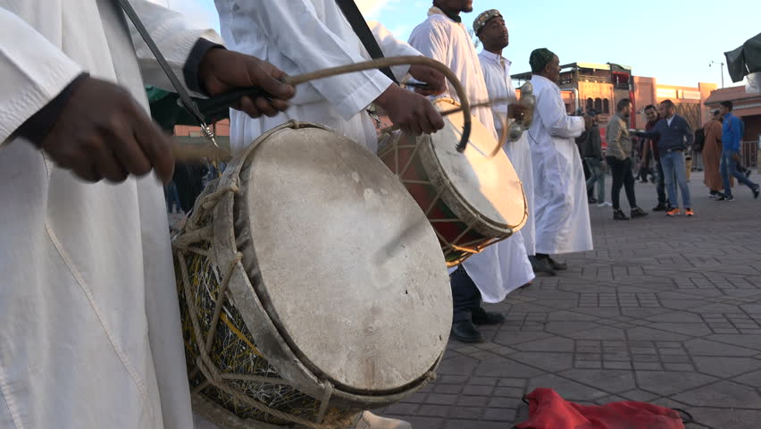 MARRAKESH, MOROCCO - DECEMBER 2016: Closeup of drums of dancers and musicians wearing traditional outfits on the Djemaa el Fna square in Marrakech, Morocco