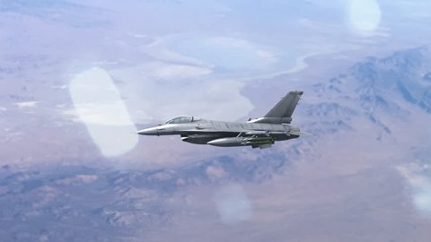 4k, F-16 fighter jet, flying high over the desert.