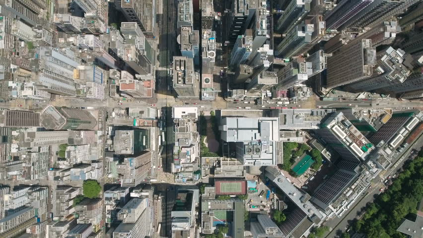 Abstract aerial drone footage of rooftops and streets in the densely populated Kowloon area in Hong Kong, one of Asia's most iconic modern cities.  #23168224