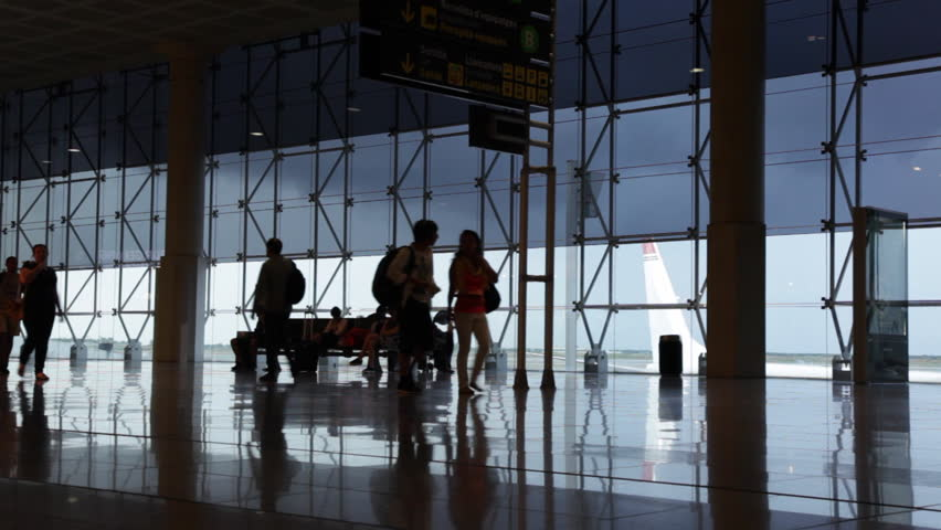 Barcelona, CIRCA July 2016: Silhouettes of passengers waiting for their flights, at Barcelona airport.