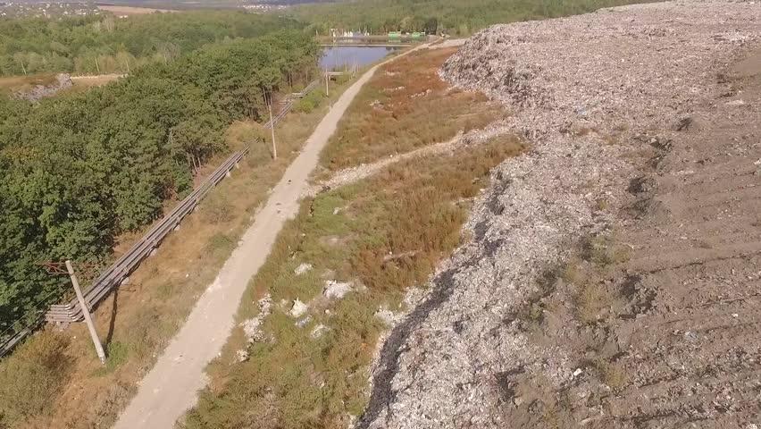 Aerial. Flying around huge rock of trash over  garbage dump | Shutterstock HD Video #23180524