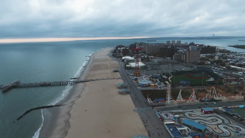 Aerial drone footage of New York City's Coney Island against storm clouds in the sky. Shot in Brooklyn during the Autumn of 2016 in 4k.