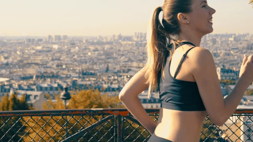 Woman running. Morning runner on the street with beautiful city view in Paris under sunlight.  | Shutterstock HD Video #23224174