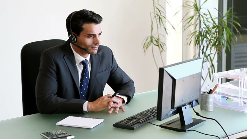 Businessman Talking On His Headset In Office Hd Stock Video Clip