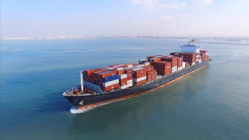 Circa, Circa, January 18, 2017: Aerial footage a large container ship leaving a commercial port, heading for it's next destination port. #23280994