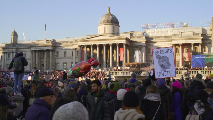 LONDON, UK. January 21, 2017. Women on the march on Trafalgar square, protest against the inauguration of Donald Trump. Close-up.