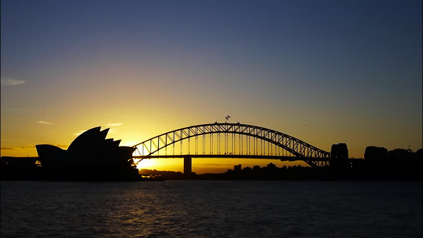 a time lapse of the sun setting on Sydney Harbour