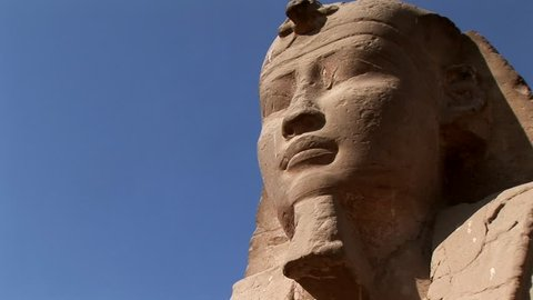 A Statue in Sphinxes Avenue Luxor Temple Egypt Tilt up a statue in the Avenue of Sphinxes in Luxor temple thebe Egypt nile river unesco site