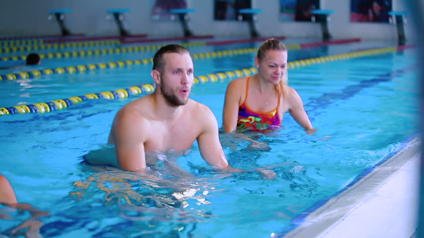 Three Young People Doing Water Exercises On The Trainers In Swimming Pool Stock Footage Video 23379394