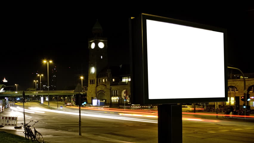Billboard at night. Long-term exposure and time-lapse effect simulates a high advertising coverage.