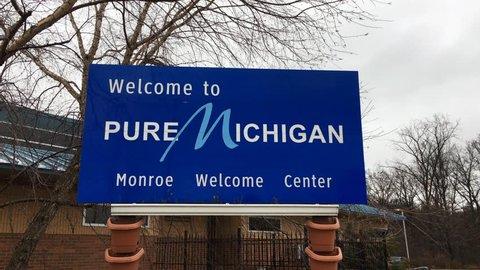 Monroe, mi - circa january, 2017 - a daytime establishing shot of the  welcome to michigan sign in monroe, michigan