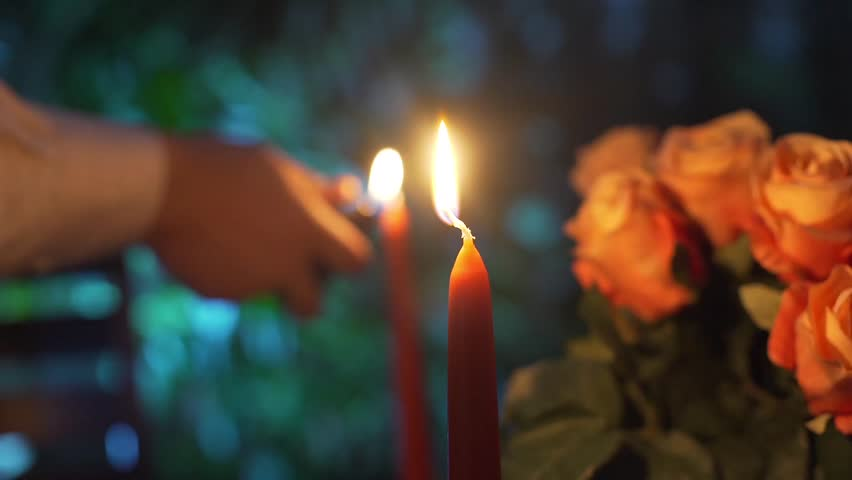 Close up shot of a man that lights candles. Valentines day. making a marriage proposal.