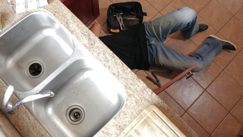 Man Fixing Sink In Kitchen Stock Footage Video 2981293 | Shutterstock