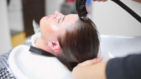 Hairdresser washes woman's hair in the beauty studio,spa and healthy mask for hair, beauty treatment, woman in spa beauty salon