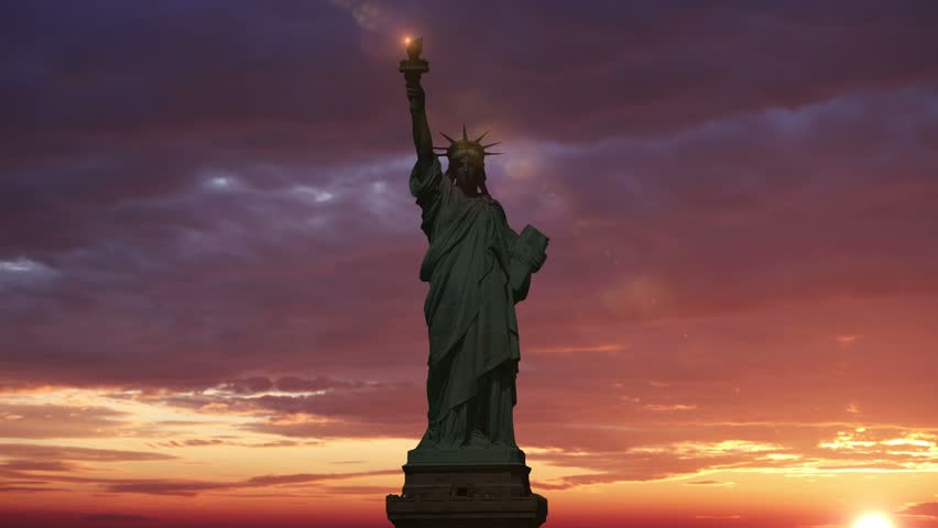 The Statue of Liberty, Sunrise Time Lapse. Sunbeam lights the torch of the statue of liberty. Animation.