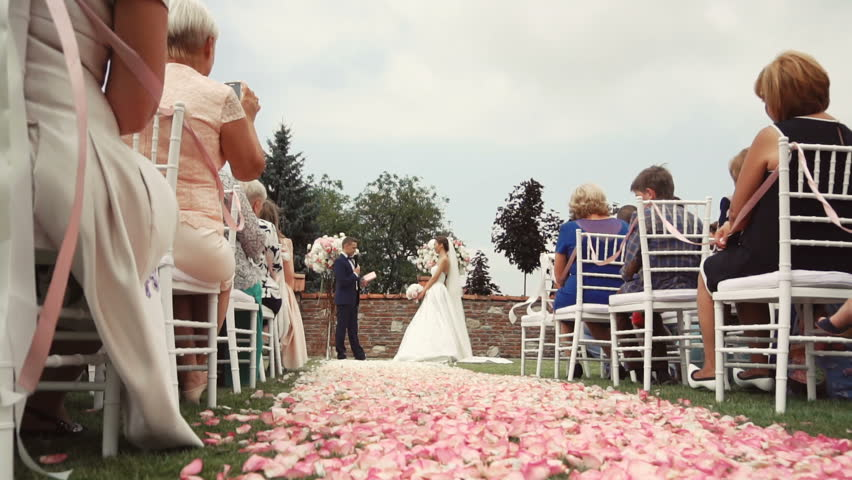 Wedding Ceremony Location With Bride And Groom Pink Petals Path Beetwen White Guests Chairs