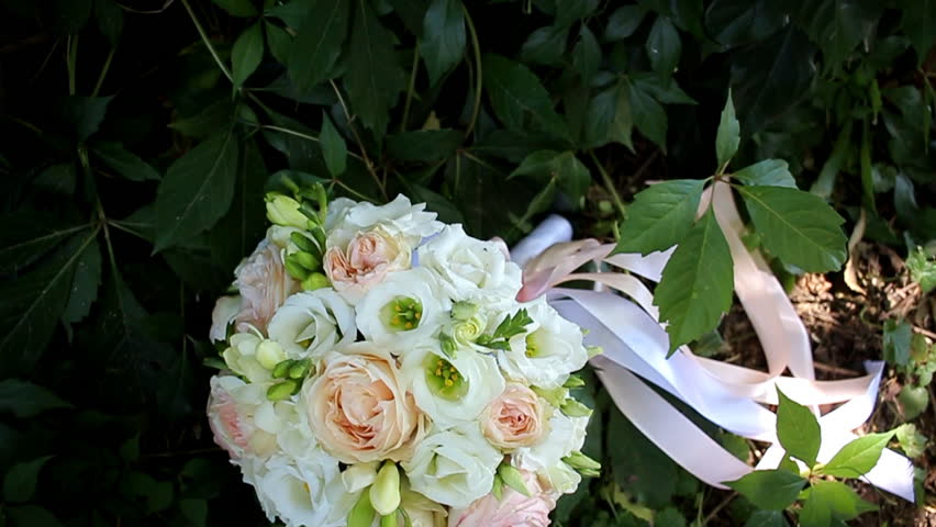 Bridal bouquet on grass with tape | Shutterstock HD Video #23566570