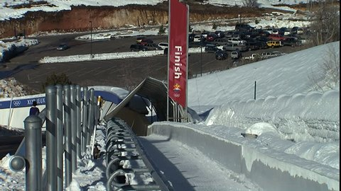 PARK CITY, UT - CIRCA 2004: Bobsled coming into finish line in Park City winter olympics complex.