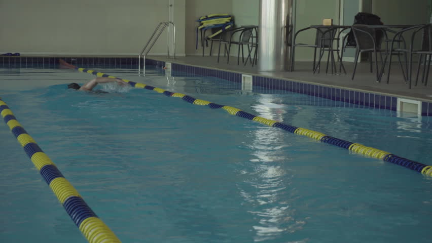 Training Male Swimmer In The Pool. Active Sports In The Water. Water Sports  And