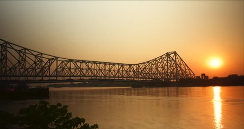 Time lapse of sunset with the Howrah Bridge in busy Calcutta, India.