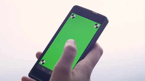 Business woman using a Smart phone Touchscreen CHROMA KEY- Close-up , Fingers make gestures touching and swiping and scrolling the screen of a modern smartphone