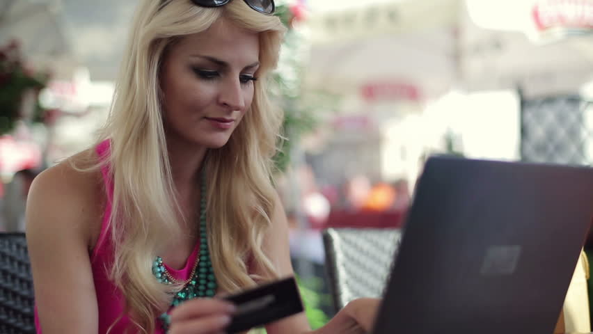 Woman doing online shopping in cafe