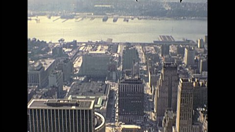 New York city, United States of America - circa 1970: vintage cityscape of NYC and East river from the Top of the Empire State Building and Macys Building.