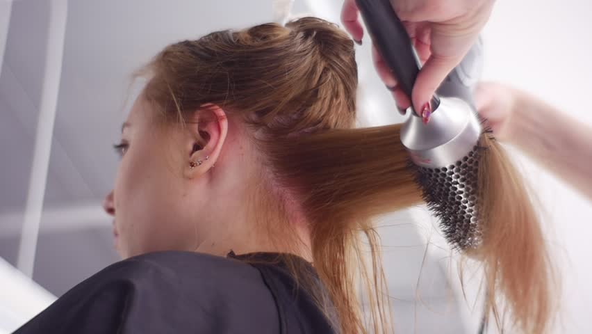 Hair-Saving Tips, Hairs Blow-Drying, the Best Technique. Slow Motion. Taken Down Up. Hair Care. the Hairs Are Separated Into Sections and Fixed Up. Salon Hair Treatment by Well Qualified Hairdresser. | Shutterstock HD Video #23677417