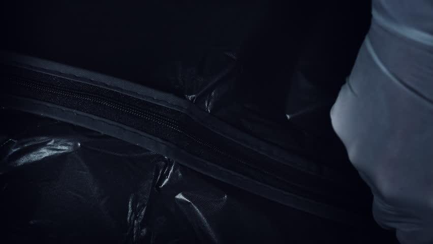 4K Crime Morgue. Black Bag Opens with Dead Body