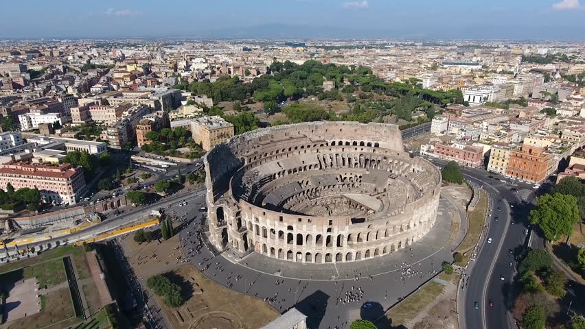 Aerial flying towards Colosseum also known as Coliseum or Flavian Amphitheater or Colosseo oval amphitheatre centre Rome Italy largest amphitheatre ever built popular tourist attraction in Italy 4k